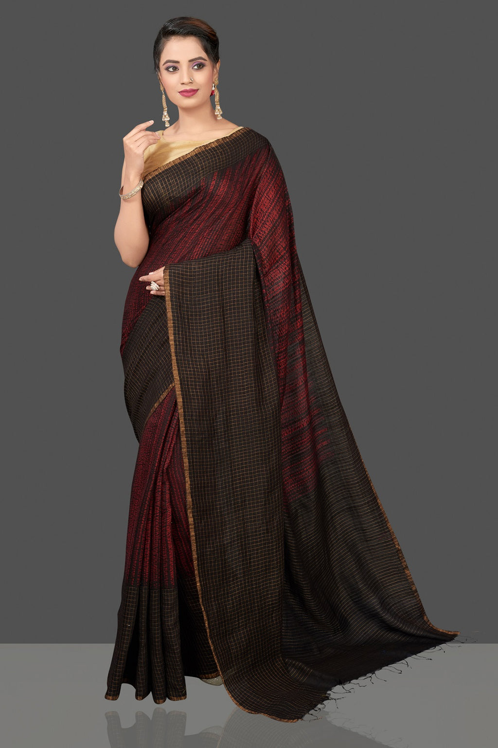 Shop gorgeous black and red matka shibori sari online in USA with check zari border. Flaunt Indian fashion in USA with a stunning collection of handwoven sarees, cotton sarees, pure silk sarees, printed saris in USA from Pure Elegance Indian saree store in USA.-full view