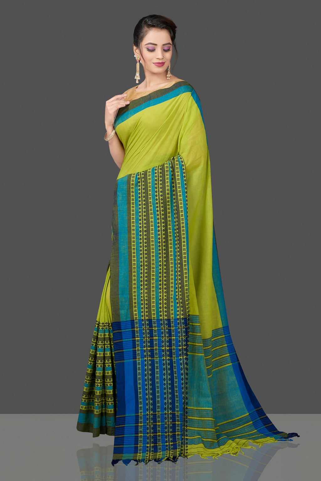 Shop gorgeous green cotton saree online in USA with weave border and pallu. Flaunt Indian fashion in USA with a stunning collection of handwoven sarees, cotton sarees, pure silk sarees, printed saris in USA from Pure Elegance Indian saree store in USA.-full view
