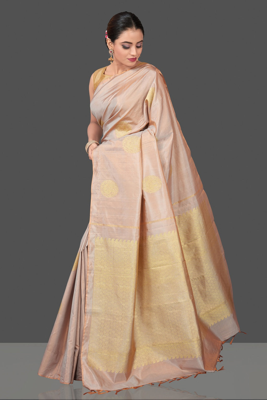 Shop stunning ivory borderless Kanjivaram silk saree online in USA with golden zari buta. Be the center of attraction at weddings and festive occasions in the stunning handwoven silk sarees, Kanchipuram silk sarees, zari work sarees, Banarasi sarees from Pure Elegance Indian saree store in USA.-full view