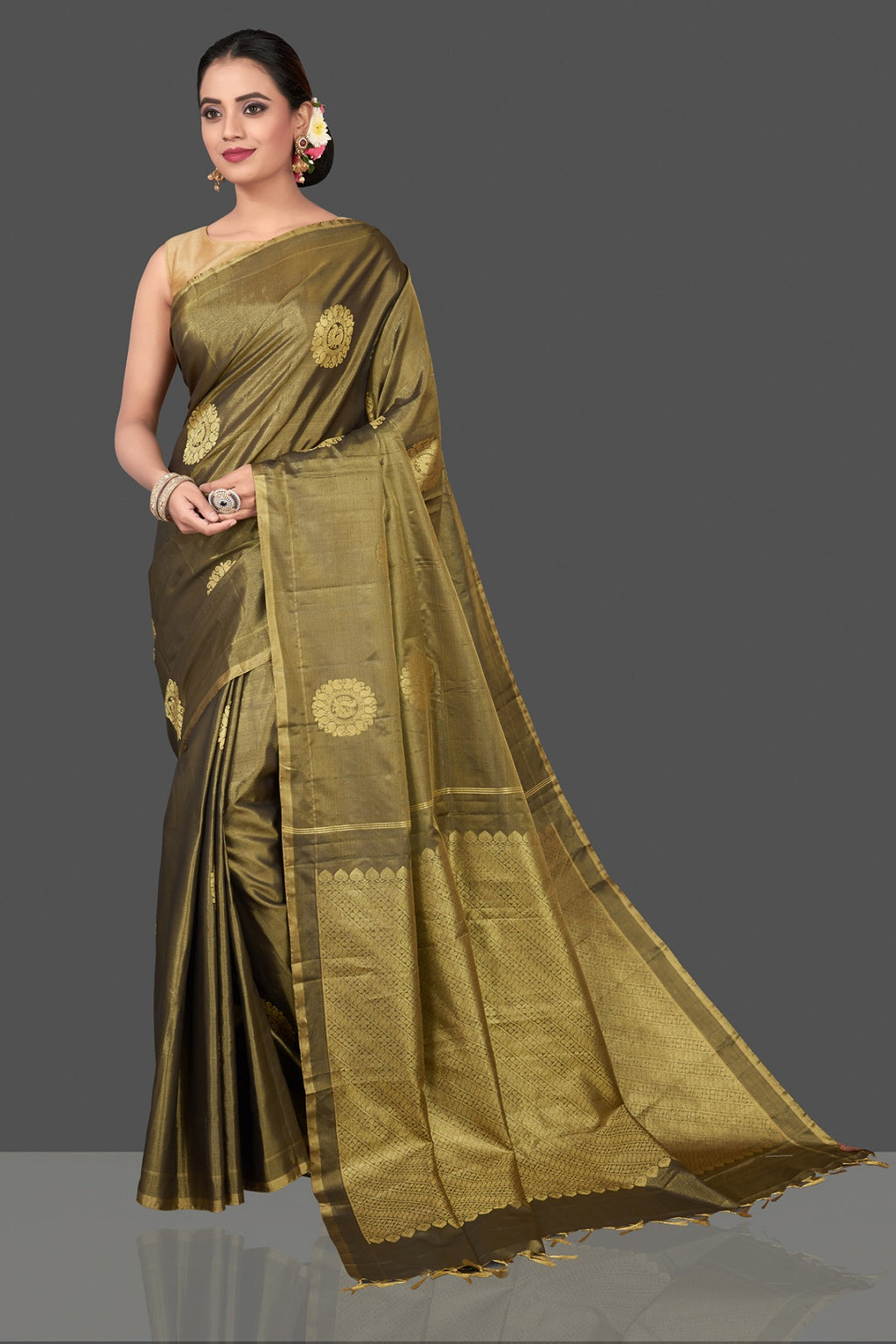 Buy gorgeous olive green handloom borderless Kanjivaram silk saree online in USA with golden zari buta. Be the center of attraction at weddings and festive occasions in the stunning handwoven silk sarees, Kanchipuram silk sarees, zari work sarees, Banarasi sarees from Pure Elegance Indian saree store in USA.-full view