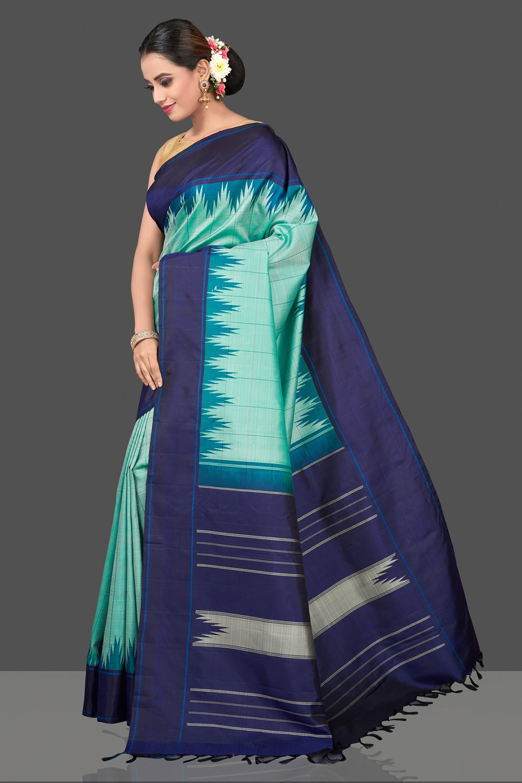 Shop beautiful mint green Kanjivaram silk sari online in USA with blue temple border. Be the center of attraction at weddings and festive occasions in the stunning handwoven silk sarees, Kanchipuram silk sarees, zari work sarees, Banarasi sarees from Pure Elegance Indian saree store in USA.-full view