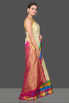 Buy beautiful off-white check Kanjivaram silk sari online in USA with multicolor check border. Be the center of attraction at weddings and festive occasions in the stunning handwoven silk sarees, Kanchipuram silk sarees, zari work sarees, Banarasi sarees from Pure Elegance Indian saree store in USA.-side