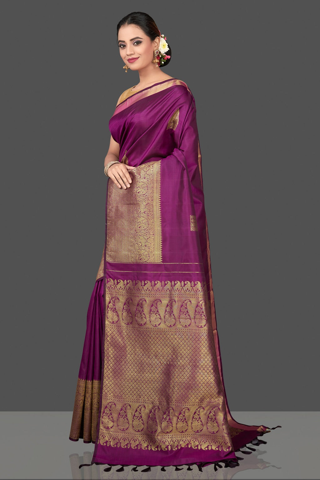 Shop gorgeous purple Kanjivaram silk saree online in USA with temple zari buta and zari border. Be the center of attraction at weddings and festive occasions in the stunning handwoven silk sarees, Kanchipuram silk sarees, zari work sarees, Banarasi sarees from Pure Elegance Indian saree store in USA.-full view