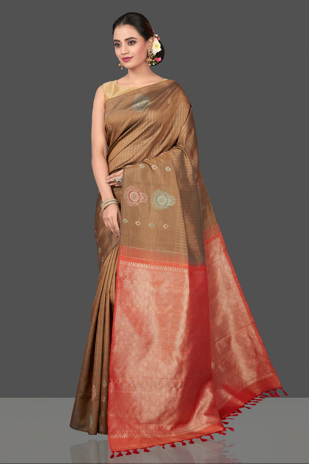 Shop stunning light brown Kanjivaram silk saree online in USA with zari buta border and red zari pallu. Be the center of attraction at weddings and festive occasions in the stunning handwoven silk sarees, Kanchipuram silk sarees, zari work sarees, Banarasi sarees from Pure Elegance Indian saree store in USA.-full view
