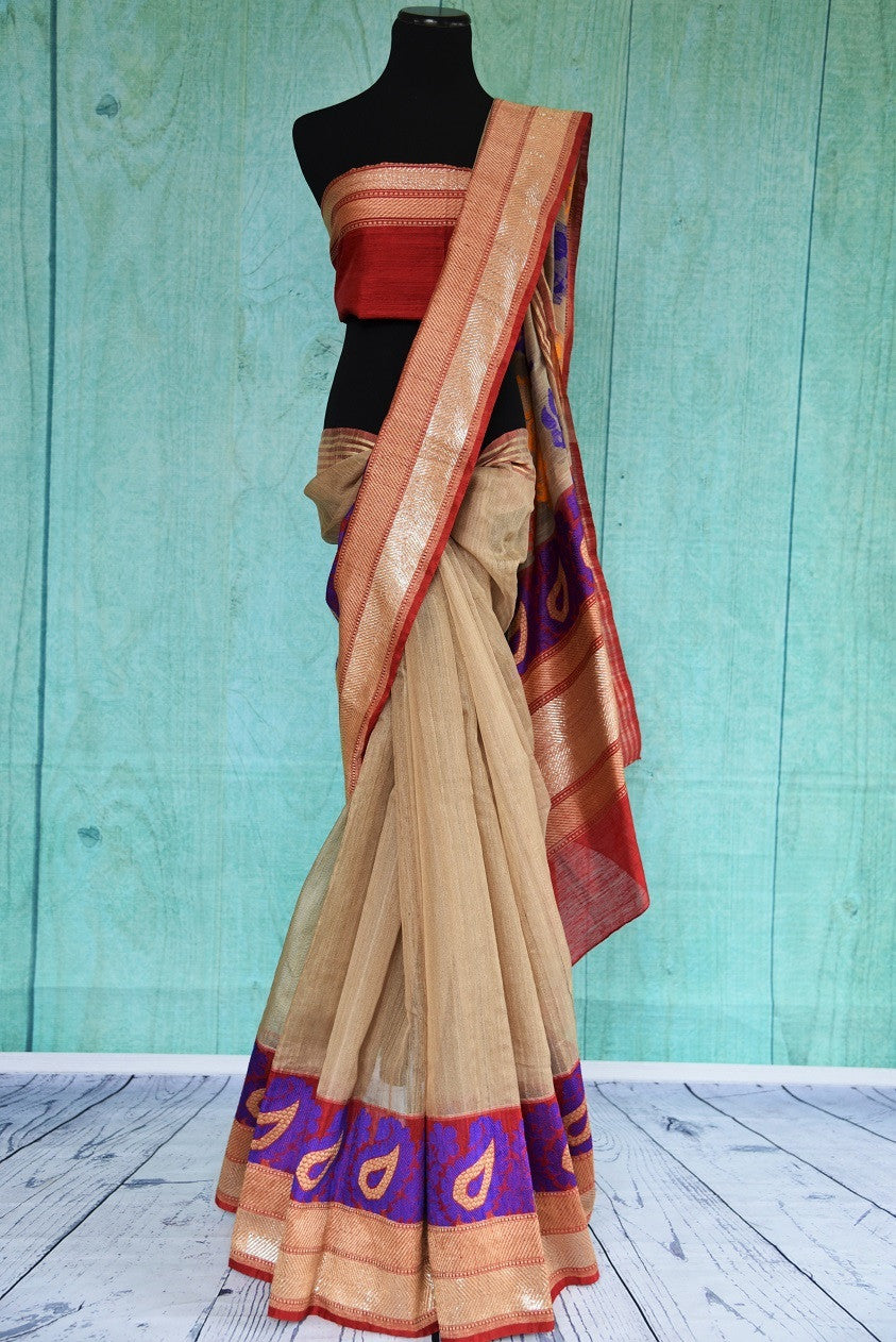 90B948 Traditional matka resham Banarasi saree at our Indian clothing store in USA. The cream saree with multicolor border and pallu and a red blouse is an evergreen pick you just cannot go wrong with!