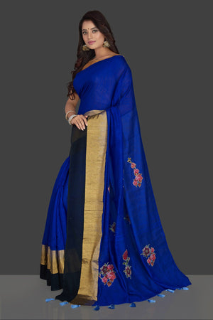 Buy beautiful indigo blue floral applique linen saree online in USA with floral saree blouse. Radiate elegance with designer sarees with blouse, linen sarees from Pure Elegance Indian fashion boutique in USA. We bring a especially curated collection of ethnic saris for Indian women in USA under one roof!-pallu