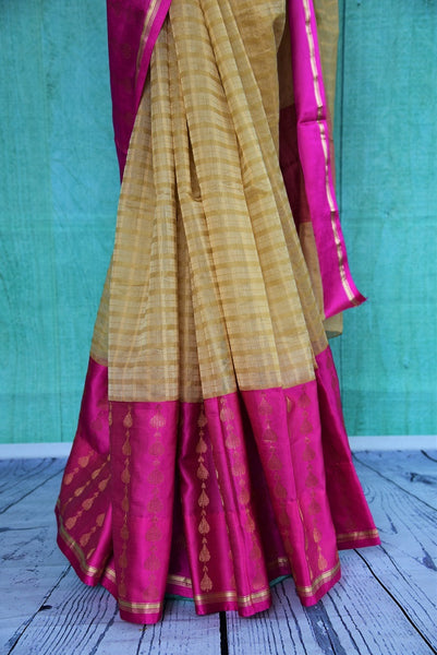 90B280 Shop this beige and pink muga Banarasi saree online at Pure Elegance. Topped with a pink border and blouse, this one makes for an ideal party or festive wear Indian outfit.