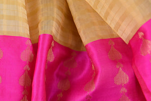 90B280 Shop this ravishing beige and pink muga Banarasi saree online in USA at our store Pure Elegance. Topped with a pink border, it makes for the perfect party or festive wear Indian outfit.