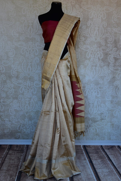 90C290 Plain cream saree with a gold border and a simple maroon blouse. The classic traditional saree can be bought online at our Indian clothing store in USA - Pure Elegance. Your wardrobe will love this timeless ethnic style pick.