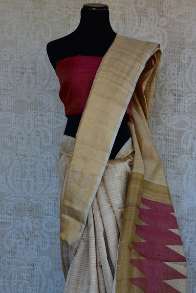 90C290 Plain cream saree with a gold border and a simple maroon blouse. The classic traditional saree can be bought online at our Indian clothing store in USA. This versatile saree can be styled in many ways for several different occasions.