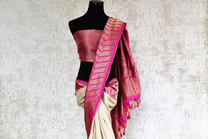 90d304 This traditional off white and pink sari will be a great addition to your Indian clothing collection. Buy this tussar Banarasi saree online at Pure Elegance. Great for pujas and Indian weddings functions, you'll love having this saree in your wardrobe.