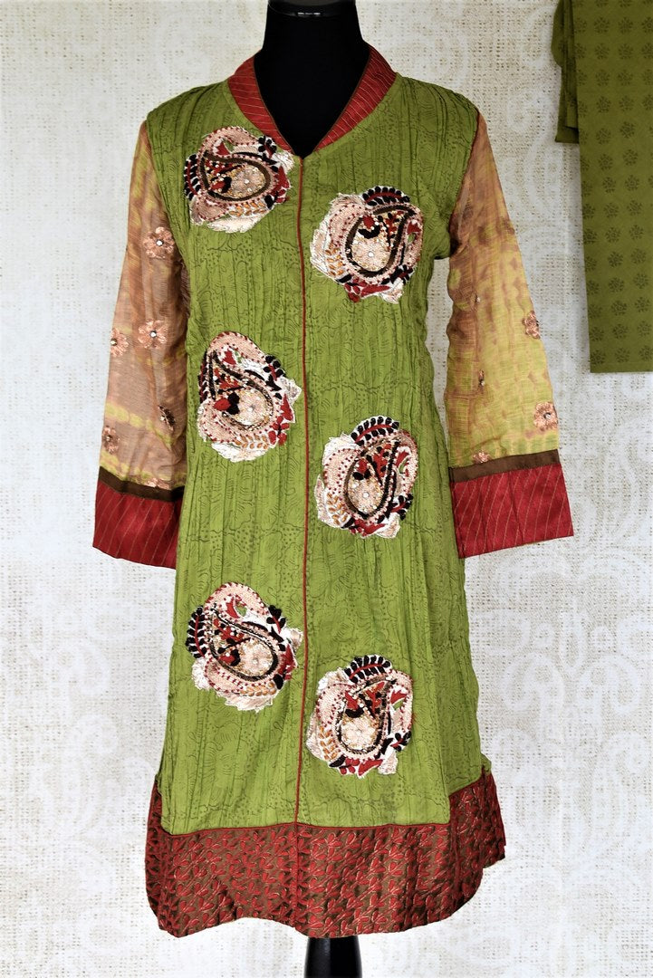 Shop green suit online in USA with embroidered paisley motifs. Choose from a range of beautiful designer salwar suits, sharara suits, palazzo suits from Pure Elegance Indian fashion store in USA.-full view