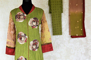 Shop green suit online in USA with embroidered paisley motifs. Choose from a range of beautiful designer salwar suits, sharara suits, palazzo suits from Pure Elegance Indian fashion store in USA.-front
