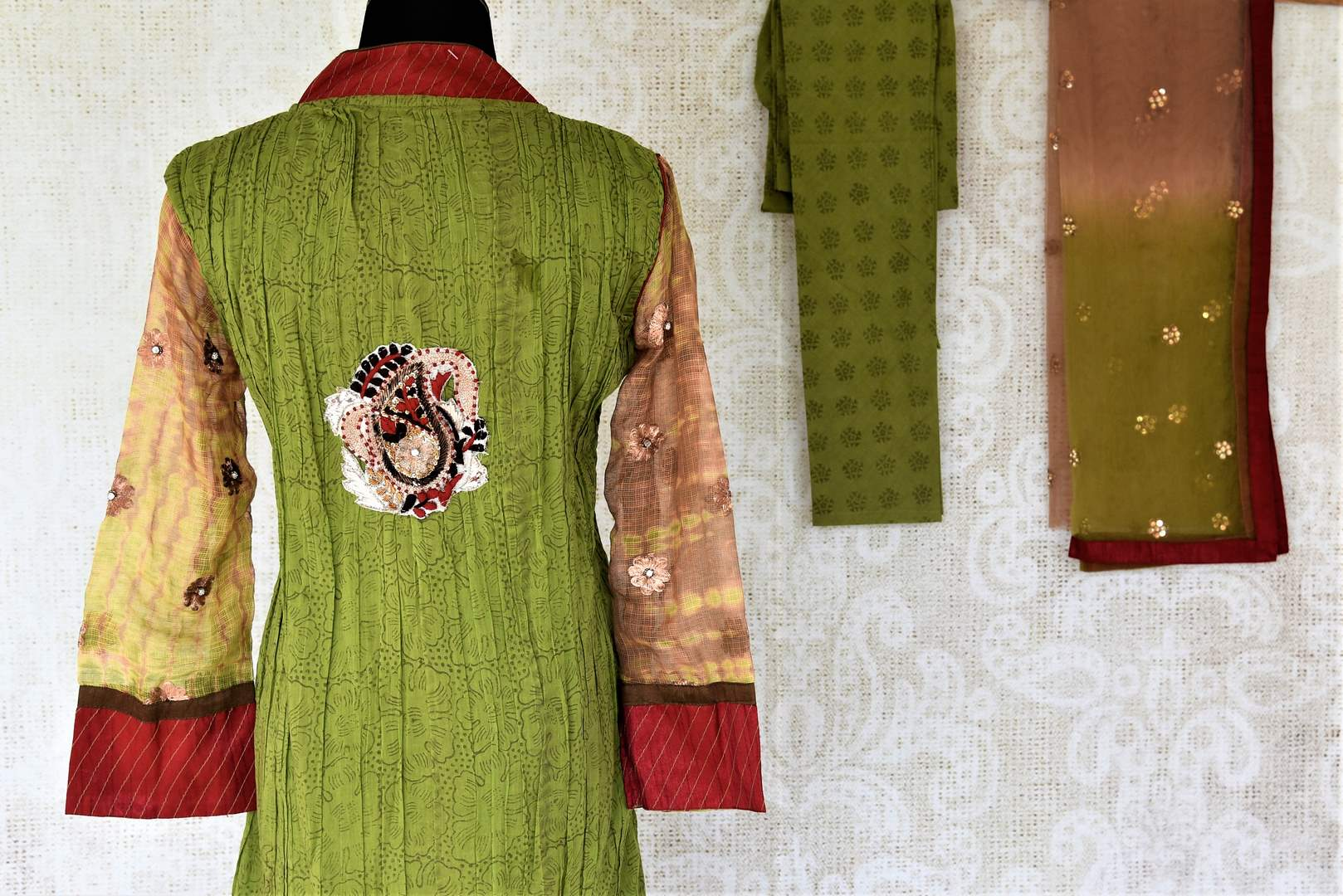 Shop green suit online in USA with embroidered paisley motifs. Choose from a range of beautiful designer salwar suits, sharara suits, palazzo suits from Pure Elegance Indian fashion store in USA.-back