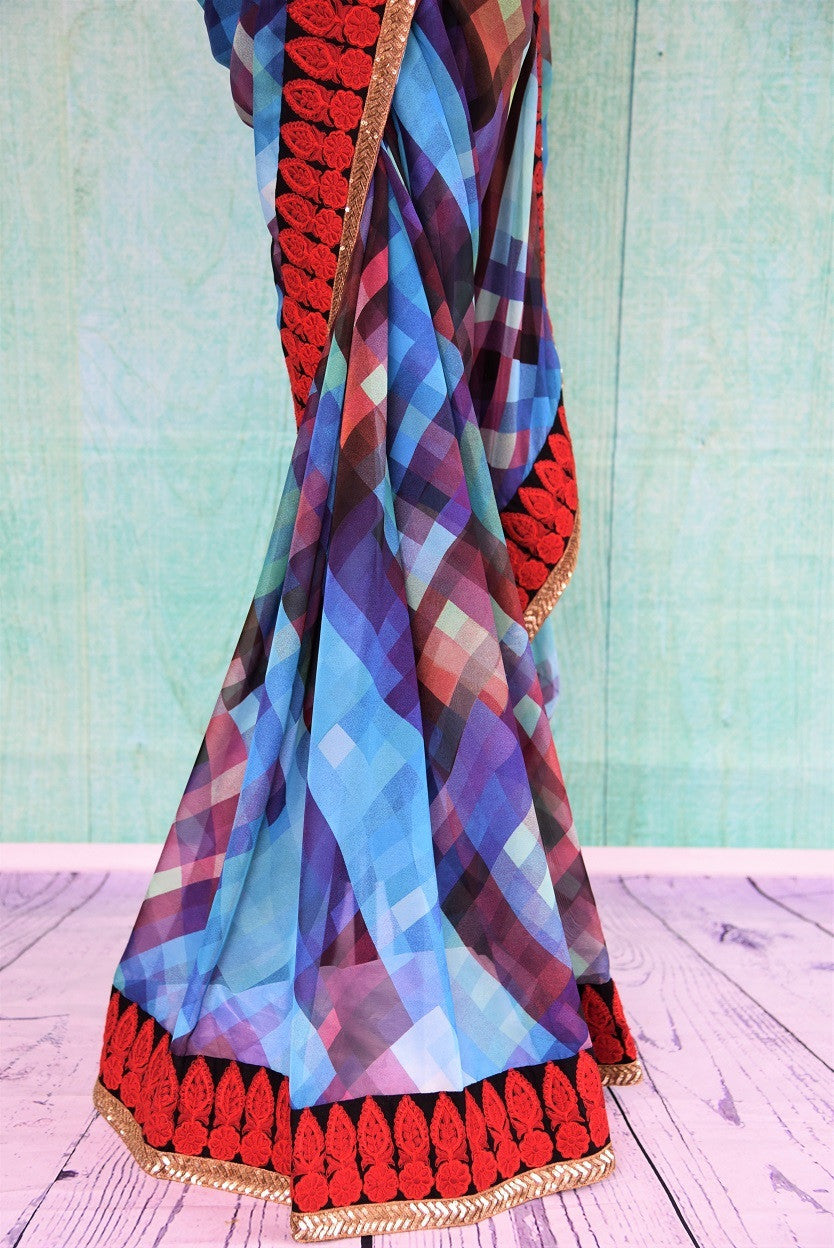 90A794 Looking for party wear sarees from India? Buy this checked, blue & purple Georgette saree with red embroidered border at our Indian clothing store online in USA - Pure Elegance.This India saree is a beautiful blend of contemporary and traditional aesthetics