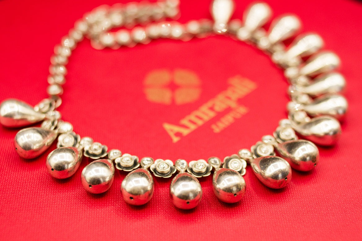 Shop Amrapali drop and flower silver necklace online in USA. Raise your ethnic style quotient on special occasions with exquisite Indian jewelry from Pure Elegance Indian clothing store in USA. Enhance your Indian look with silver gold plated jewelry, necklaces, fashion jewelry available online.-side view