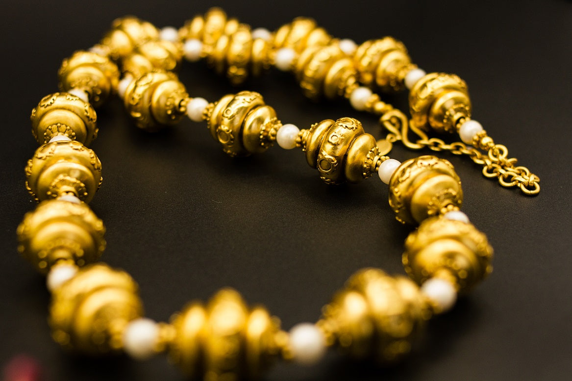 Shop Amrapali silver gold plated beads and pearls necklace online in USA. Raise your ethnic style quotient on special occasions with exquisite Indian jewelry from Pure Elegance Indian clothing store in USA. Enhance your Indian look with silver gold plated jewelry, necklaces, fashion jewelry available online.-closeup