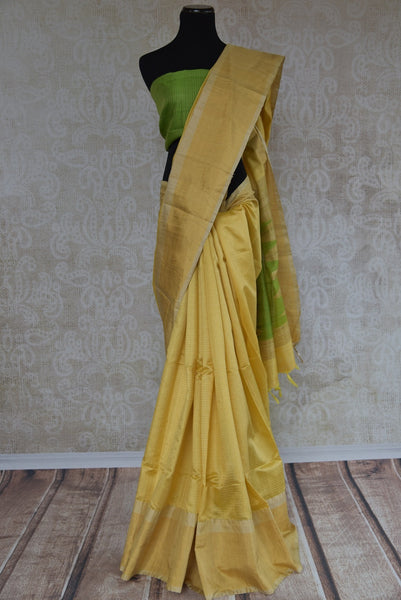90C292 Lovely lemon yellow saree with a simple green blouse and a dash of subtle gold. The simple raw silk saree, ideal for festive occasions and pujas, is available at our Indian clothing store in USA.