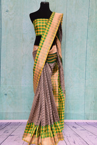 90B598 This linen saree with a traditional Banarasi border comes in a fresh pairing of green, yellow & grey. This sari makes for an ideal Indian outfit for Indian weddings, receptions and functions. The modern aesthetics combines with traditional elements gives this saree a unique look.