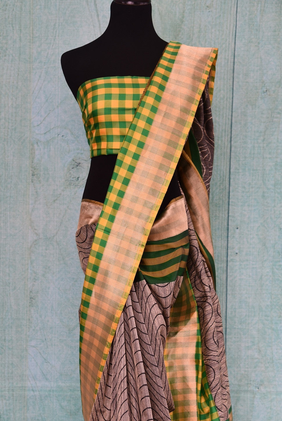 90B598 This linen saree with a traditional Banarasi border comes in a fresh pairing of green, yellow & grey. This sari makes for an ideal Indian outfit for Indian weddings, receptions and functions. The modern aesthetics combines with traditional elements gives this saree a unique look. Buy it online in USA at Pure Elegance.