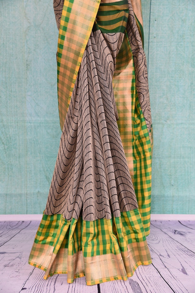 90B598 This linen saree with a traditional Banarasi border, available online in USA at our store Pure Elegance, comes in a fresh pairing of green, yellow & grey. This sari makes for an ideal Indian outfit for Indian weddings, receptions and functions.