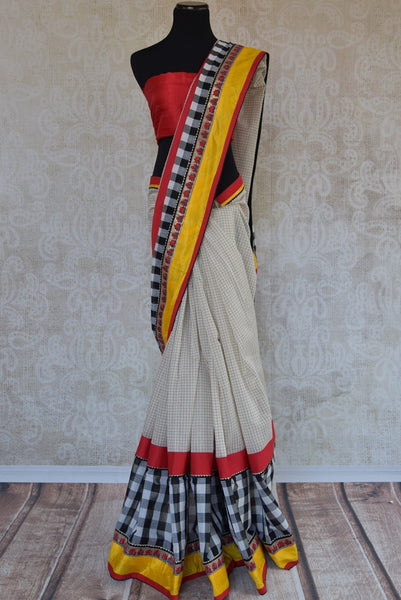 90A824 White saree with pops of yellow & red that is versatile & will work as a wedding outfit & as a party saree! Buy this linen saree online in USA at Pure Elegance and you'll love it's addition to your Indian ethnic wear collection.