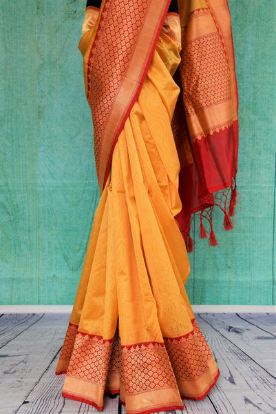 90C505 Traditional Yellow Muga Saree With Red Border