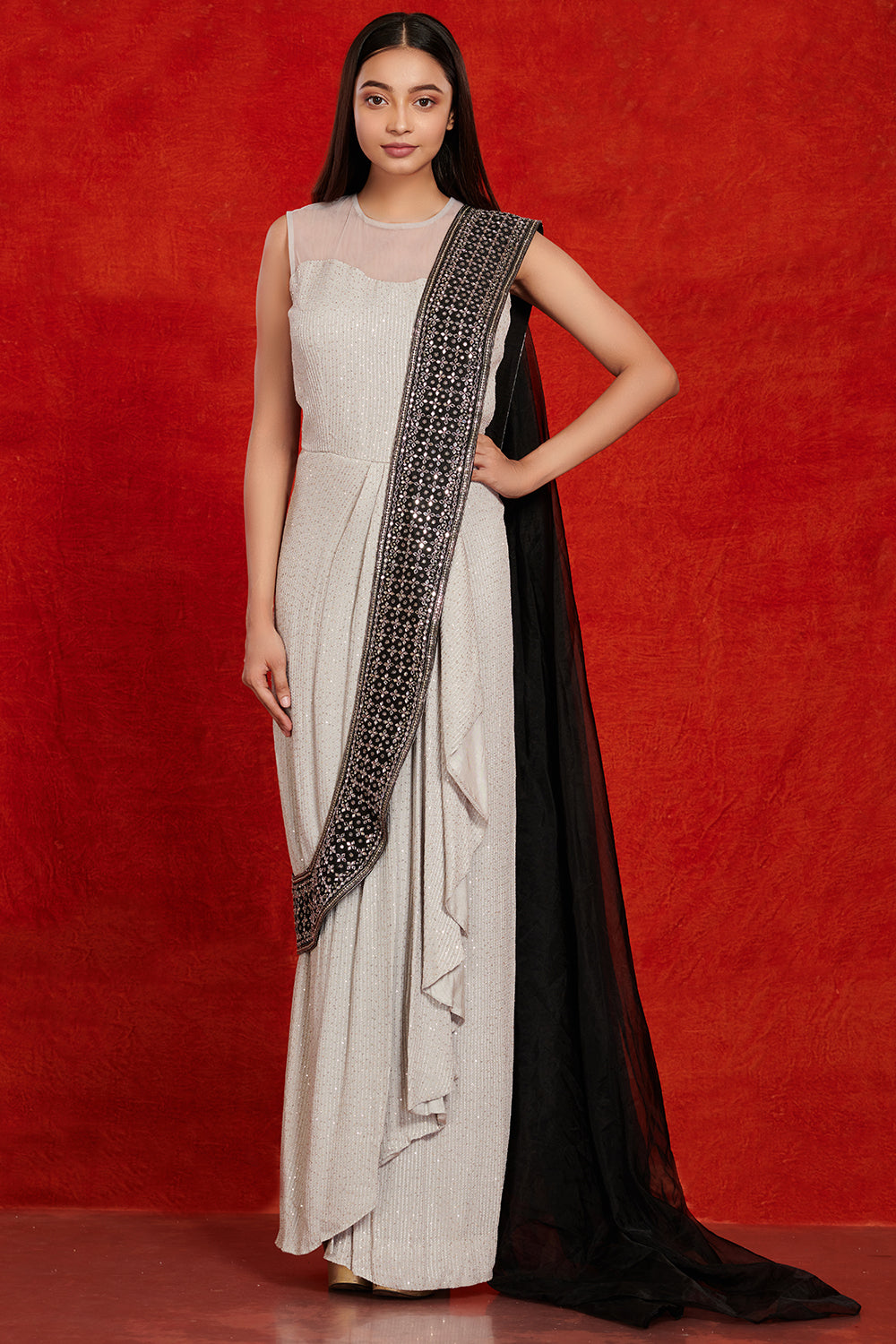 Buy stunning grey and black embellished saree gown online in USA. Make a fashion statement on festive occasions and weddings with palazzo suits, sharara suits, partywear dresses, salwar suits from Pure Elegance Indian fashion store in USA.-full view