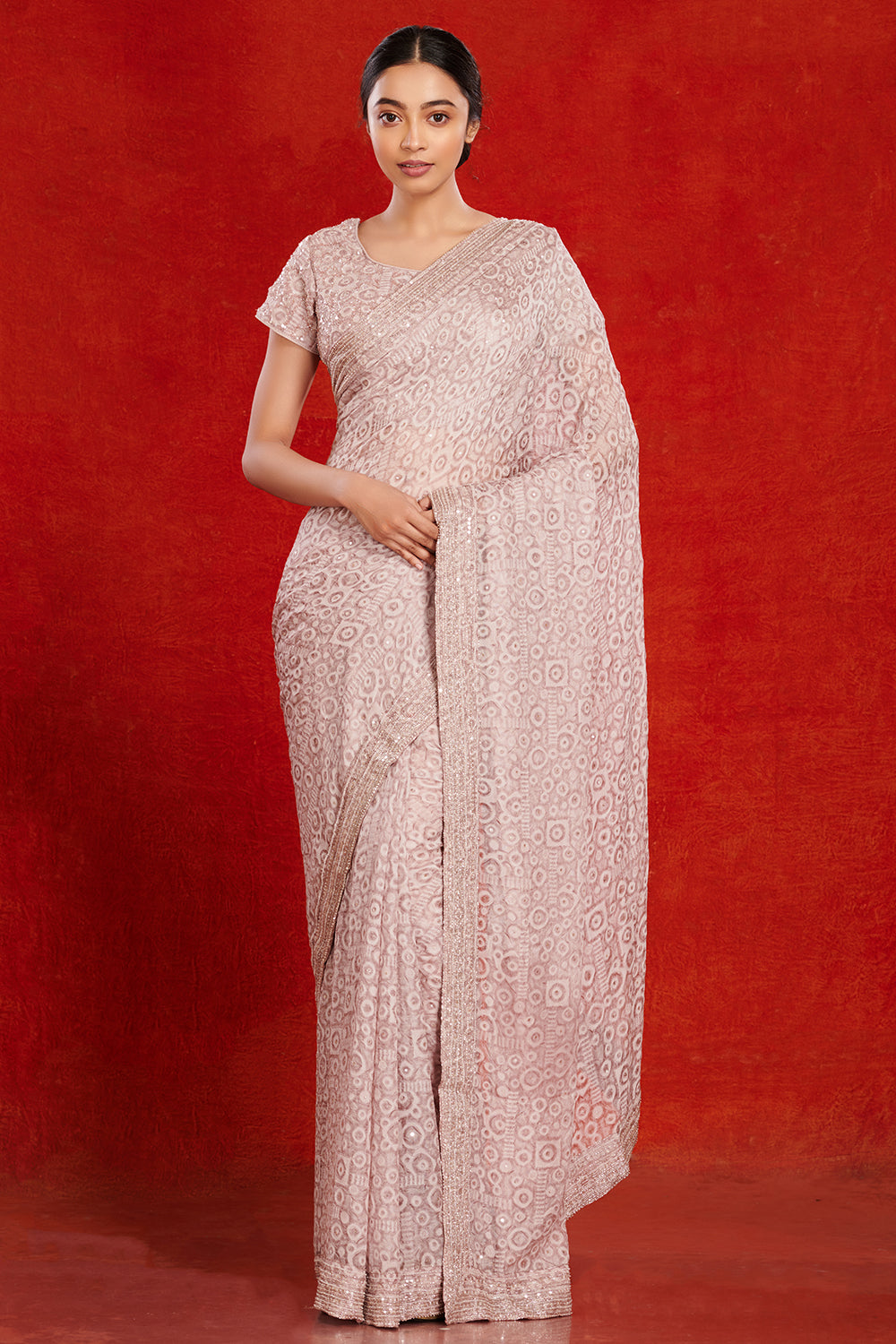 Buy stunning light pink printed chiffon saree online in USA with embellished blouse. Make a fashion statement on festive occasions and weddings with designer sarees, embroidered saris, handwoven saris, party wear sarees from Pure Elegance Indian fashion store in USA.-front