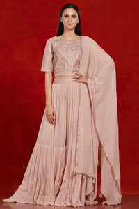Shop gorgeous dusty pink mirror work sharara suit online in USA with dupatta.  Make a fashion statement on festive occasions and weddings with designer suits, Indian dresses, Anarkali suits, palazzo suits, designer gowns, sharara suits from Pure Elegance Indian fashion store in USA.-full view