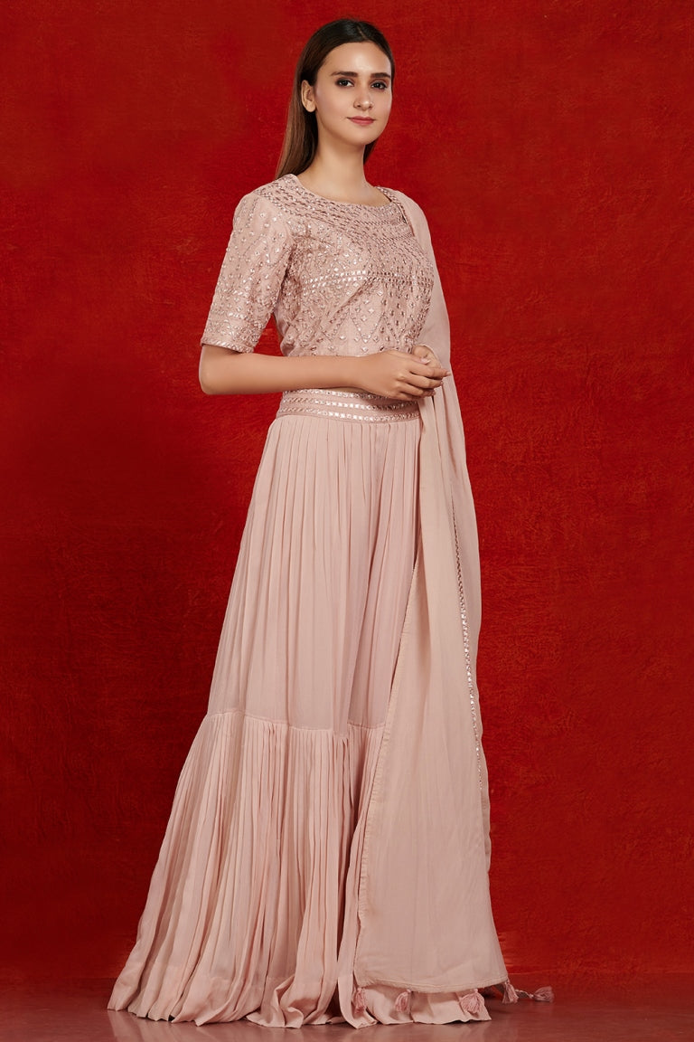 Shop gorgeous dusty pink mirror work sharara suit online in USA with dupatta.  Make a fashion statement on festive occasions and weddings with designer suits, Indian dresses, Anarkali suits, palazzo suits, designer gowns, sharara suits from Pure Elegance Indian fashion store in USA.-right