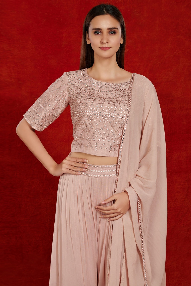 Shop gorgeous dusty pink mirror work sharara suit online in USA with dupatta.  Make a fashion statement on festive occasions and weddings with designer suits, Indian dresses, Anarkali suits, palazzo suits, designer gowns, sharara suits from Pure Elegance Indian fashion store in USA.-closeup