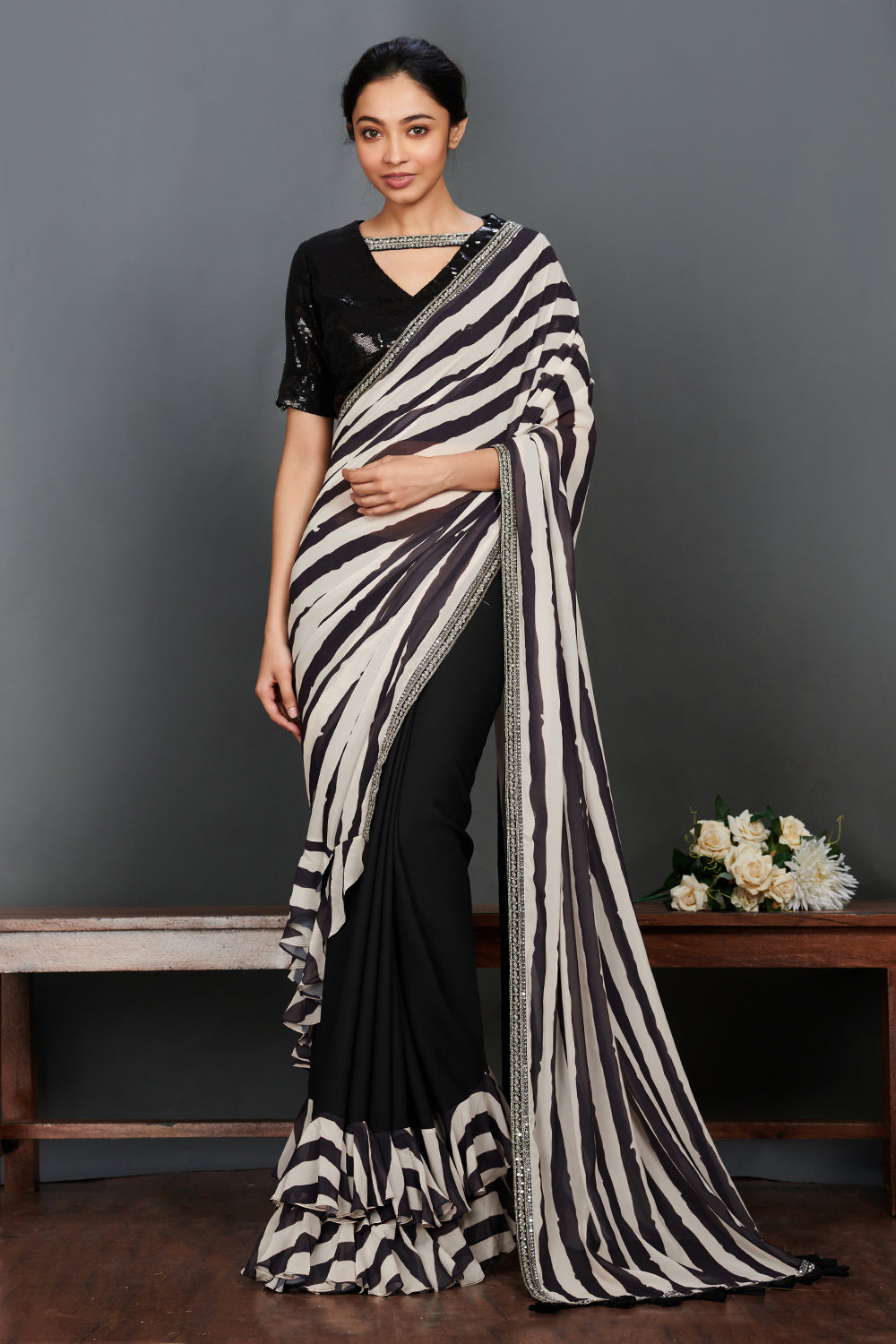 Buy stunning black and white striped saree online in USA with sequin saree blouse. Make a fashion statement on festive occasions and weddings with designer sarees, embroidered saris, handwoven saris, party wear sarees from Pure Elegance Indian fashion store in USA.-full view