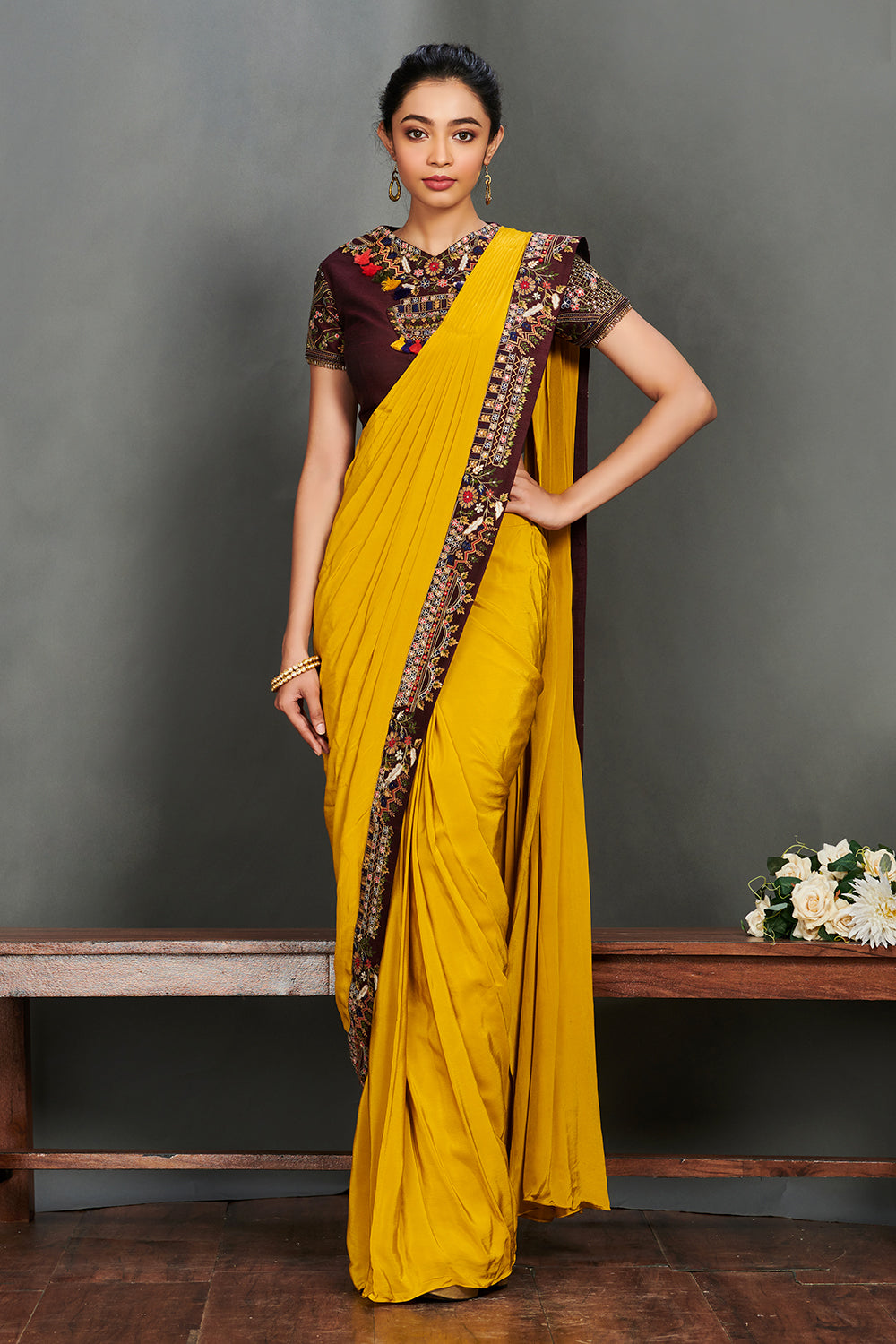 Shop stunning mustard yellow georgette saree online in USA with maroon embroidered saree blouse. Make a fashion statement on festive occasions and weddings with palazzo suits, sharara suits, partywear dresses, salwar suits from Pure Elegance Indian fashion store in USA.-full view