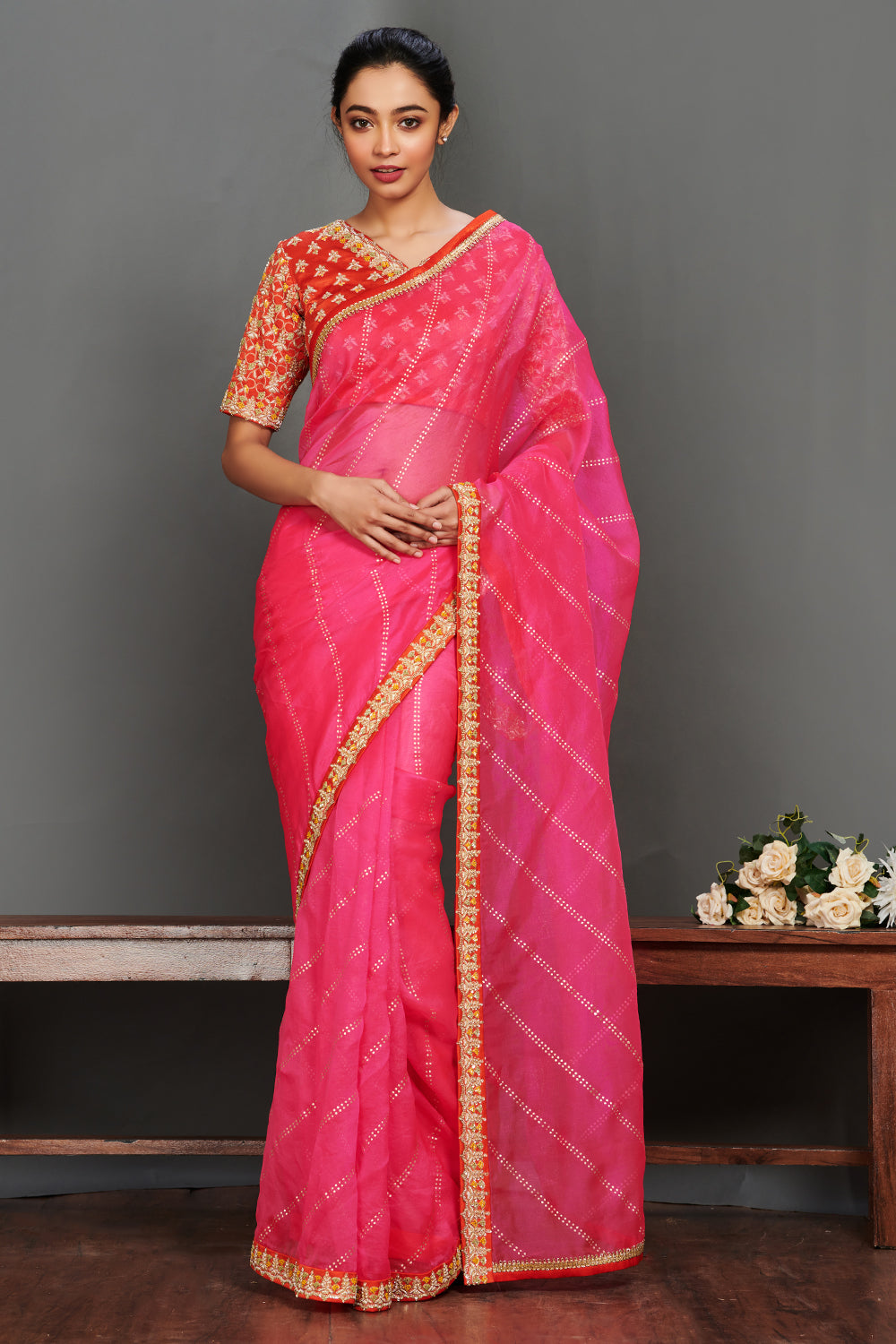 Shop gorgeous rani pink embroidered saree online in USA with red saree blouse. Make a fashion statement on festive occasions and weddings with designer sarees, embroidered saris, handwoven saris, party wear sarees from Pure Elegance Indian fashion store in USA.-full view