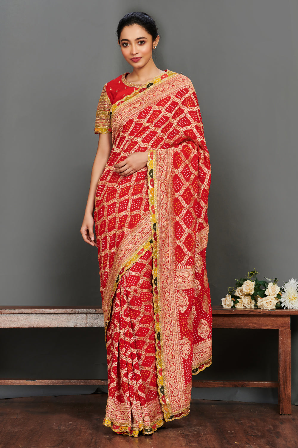 Shop gorgeous red Bandhej saree online in USA with embroidered saree blouse. Make a fashion statement on festive occasions and weddings with designer suits, Indian dresses, Anarkali suits, palazzo suits, designer gowns, sharara suits from Pure Elegance Indian fashion store in USA.-full view