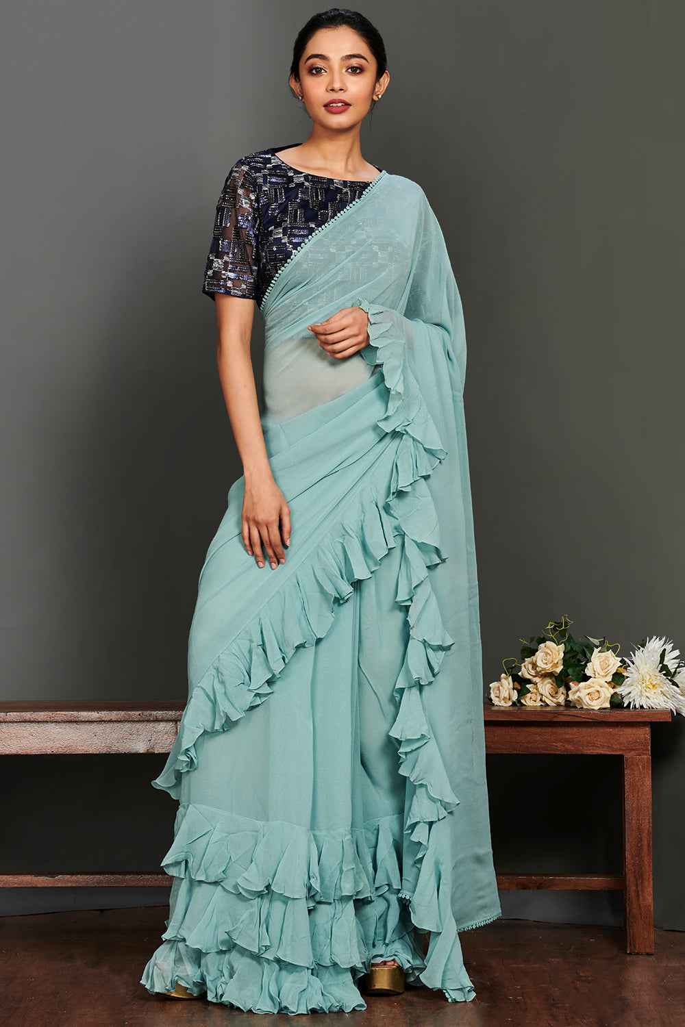 Buy stunning aqua blue georgette ruffle saree online in USA with dark blue embellished saree blouse. Make a fashion statement on festive occasions and weddings with designer suits, Indian dresses, Anarkali suits, palazzo suits, designer gowns, sharara suits from Pure Elegance Indian fashion store in USA.-full view