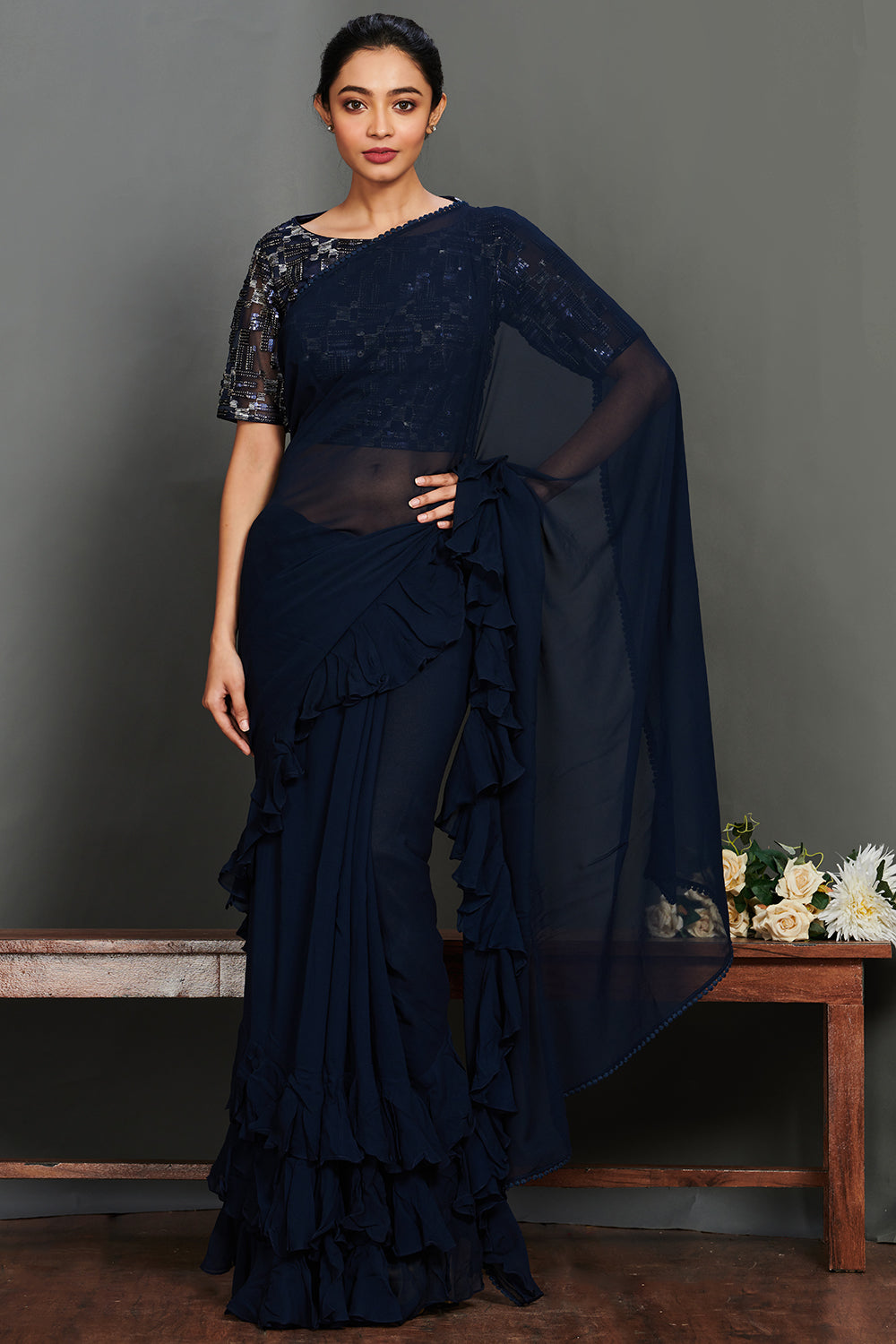 Shop gorgeous dark blue blue georgette ruffle saree online in USA with embellished saree blouse. Make a fashion statement on festive occasions and weddings with designer suits, Indian dresses, Anarkali suits, palazzo suits, designer gowns, sharara suits from Pure Elegance Indian fashion store in USA.-full view