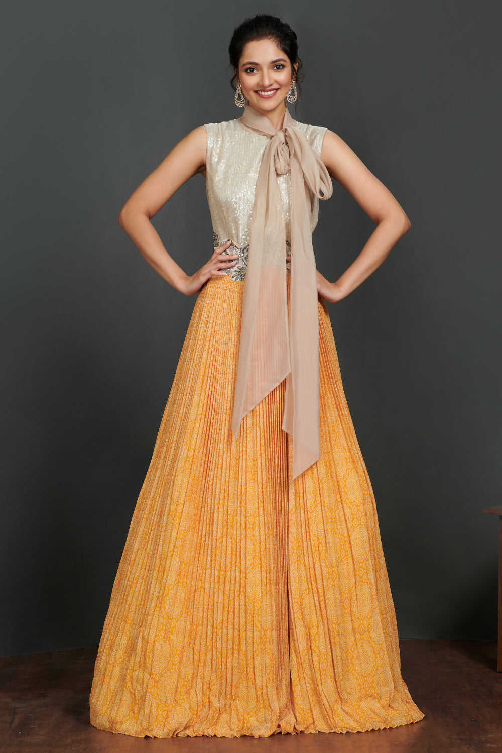 Shop beautiful silver and light orange pleated gown online in USA with scarf. Make a fashion statement on festive occasions and weddings with palazzo suits, sharara suits, partywear dresses, salwar suits from Pure Elegance Indian fashion store in USA.-full view