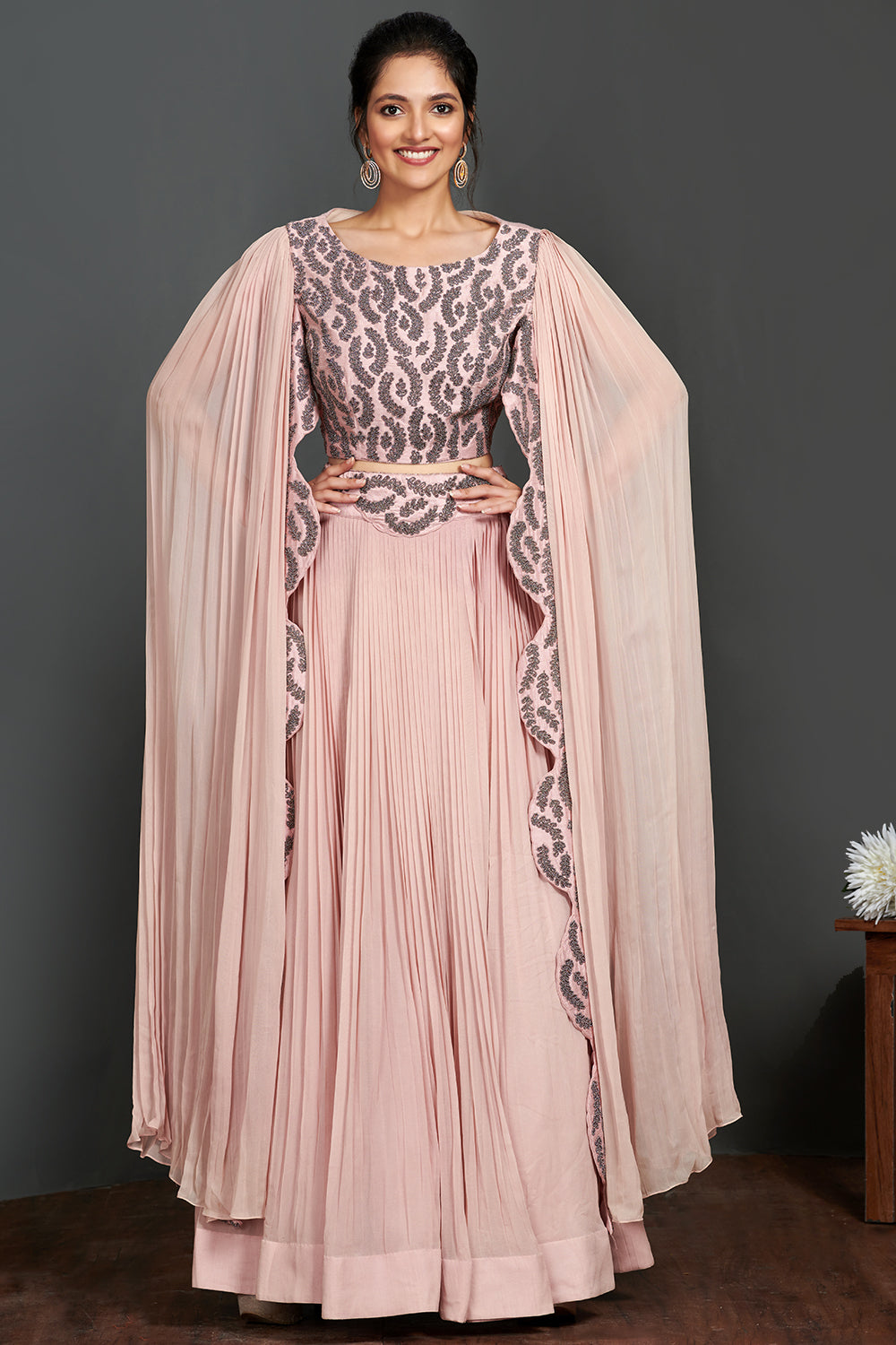 Shop beautiful rose pink embroidered cape with georgette pants online in USA. Make a fashion statement on festive occasions and weddings with palazzo suits, sharara suits, partywear dresses, salwar suits from Pure Elegance Indian fashion store in USA.-full view
