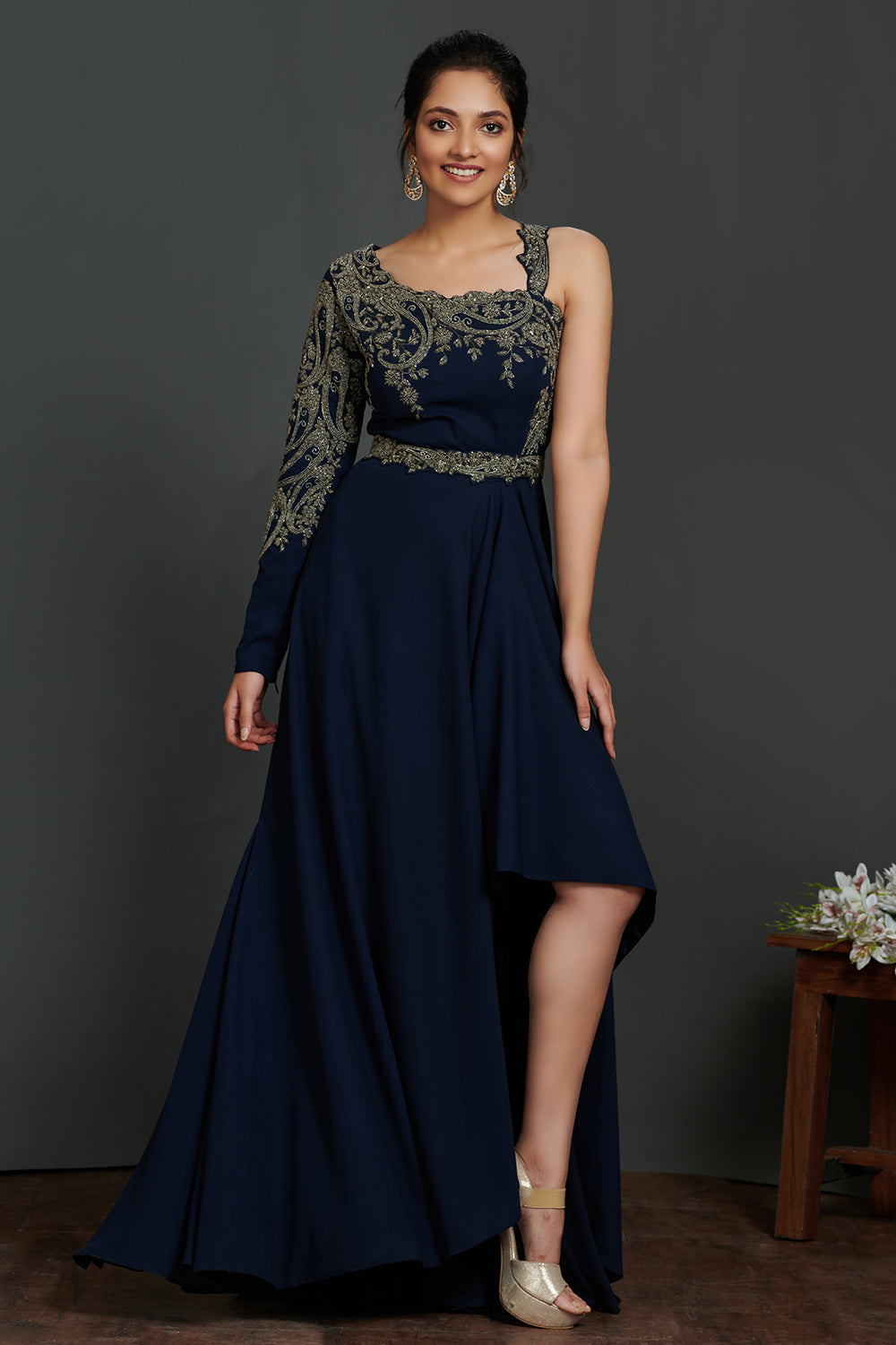 Buy beautiful navy blue antique golden embroidery asymmetric gown online in USA. Make a fashion statement on festive occasions and weddings with palazzo suits, sharara suits, partywear dresses, salwar suits from Pure Elegance Indian fashion store in USA.-full view