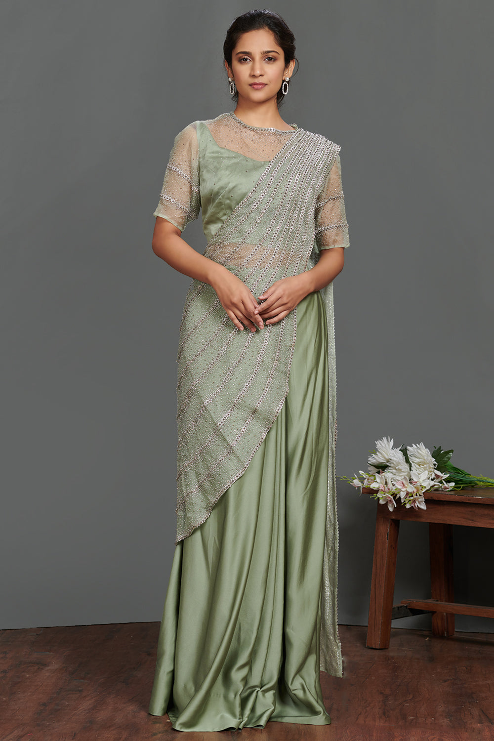 Shop beautiful green embellished lehenga saree set online in USA. Make a fashion statement on festive occasions and weddings with palazzo suits, sharara suits, partywear dresses, salwar suits from Pure Elegance Indian fashion store in USA.-full view