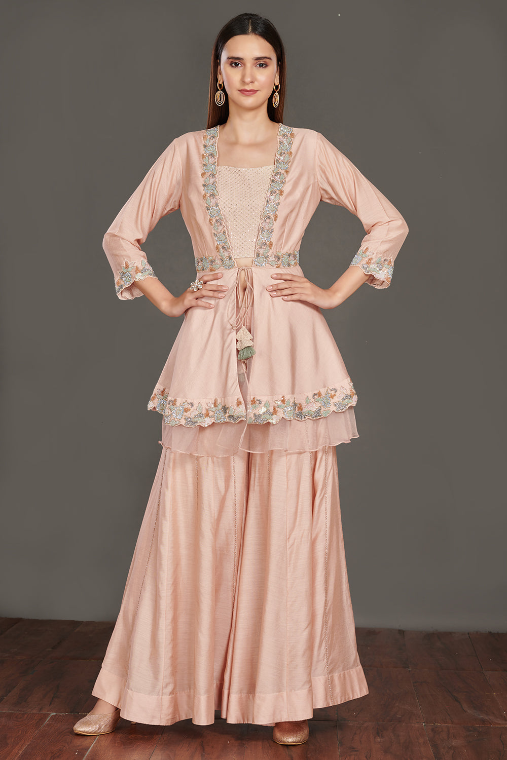 Shop beautiful light pink embroidered peplum jacket online in USA with flared palazzo. Make a fashion statement on festive occasions and weddings with palazzo suits, sharara suits, partywear dresses, salwar suits from Pure Elegance Indian fashion store in USA.-full view