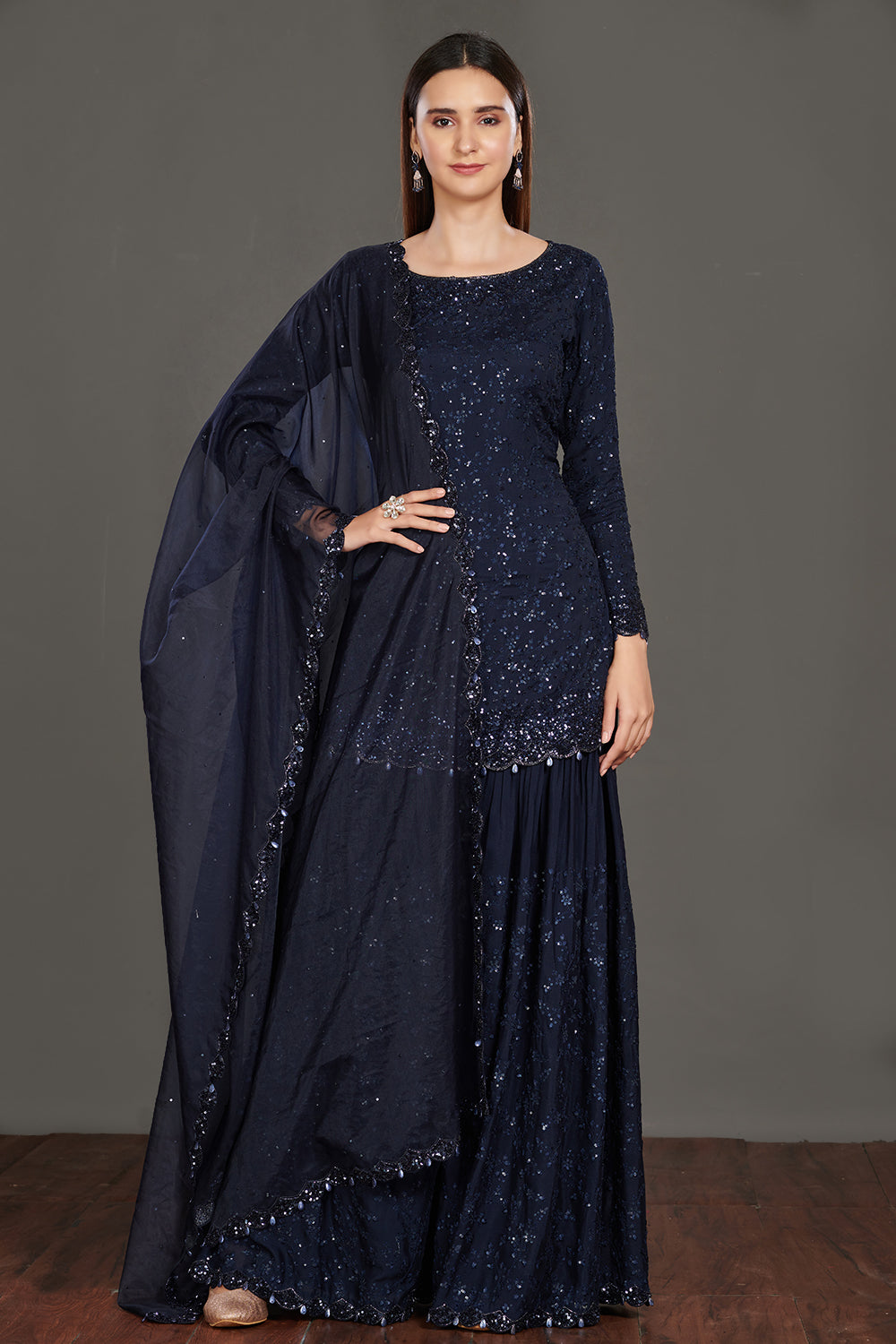 Buy stunning navy blue shimmer sharara suit online in USA. Make a fashion statement on festive occasions and weddings with palazzo suits, sharara suits, partywear dresses, salwar suits from Pure Elegance Indian fashion store in USA.-full view