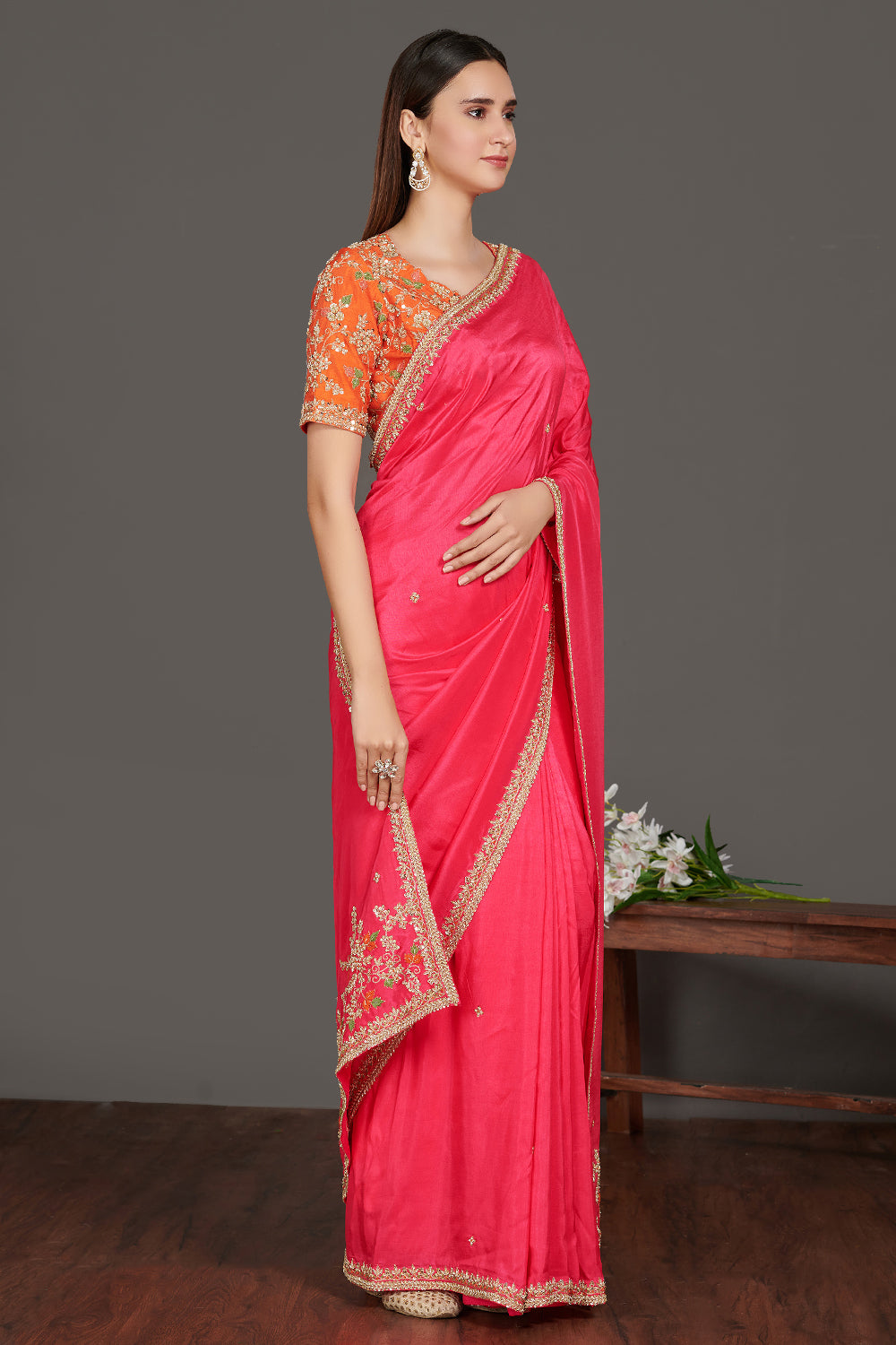 Buy beautiful pink embroidered handloom saree online in USA with orange saree blouse. Make a fashion statement on festive occasions and weddings with designer sarees, embroidered saris, handwoven saris, party wear sarees from Pure Elegance Indian fashion store in USA.-full view