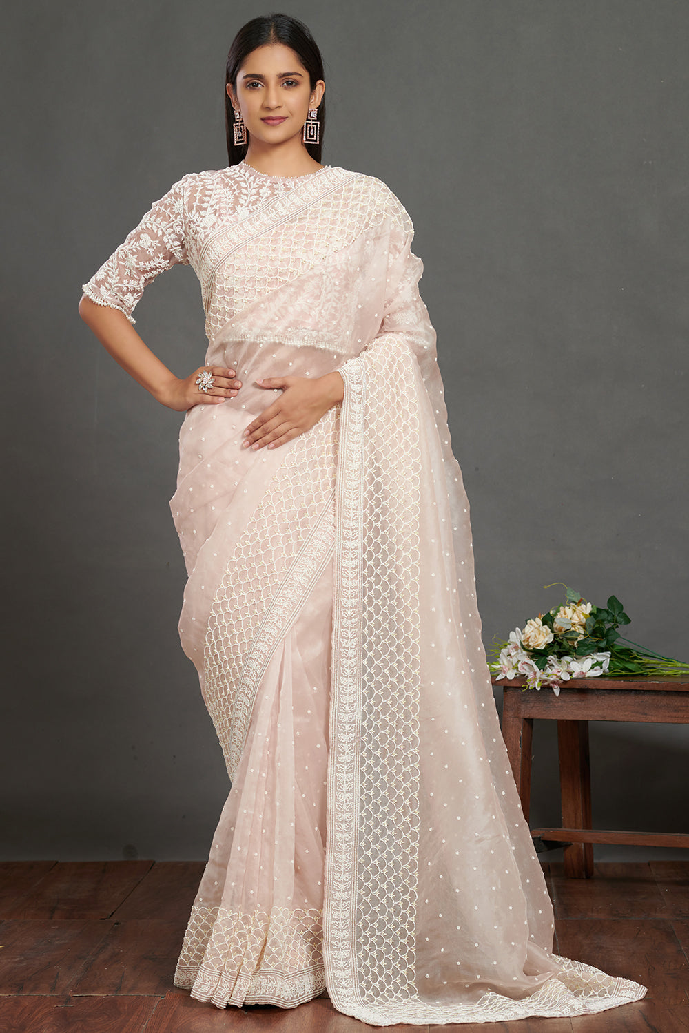 Shop gorgeous light pink lace saree online in USA with self-work saree blouse. Make a fashion statement on festive occasions and weddings with designer sarees, embroidered saris, handwoven saris, party wear sarees from Pure Elegance Indian fashion store in USA.-full view