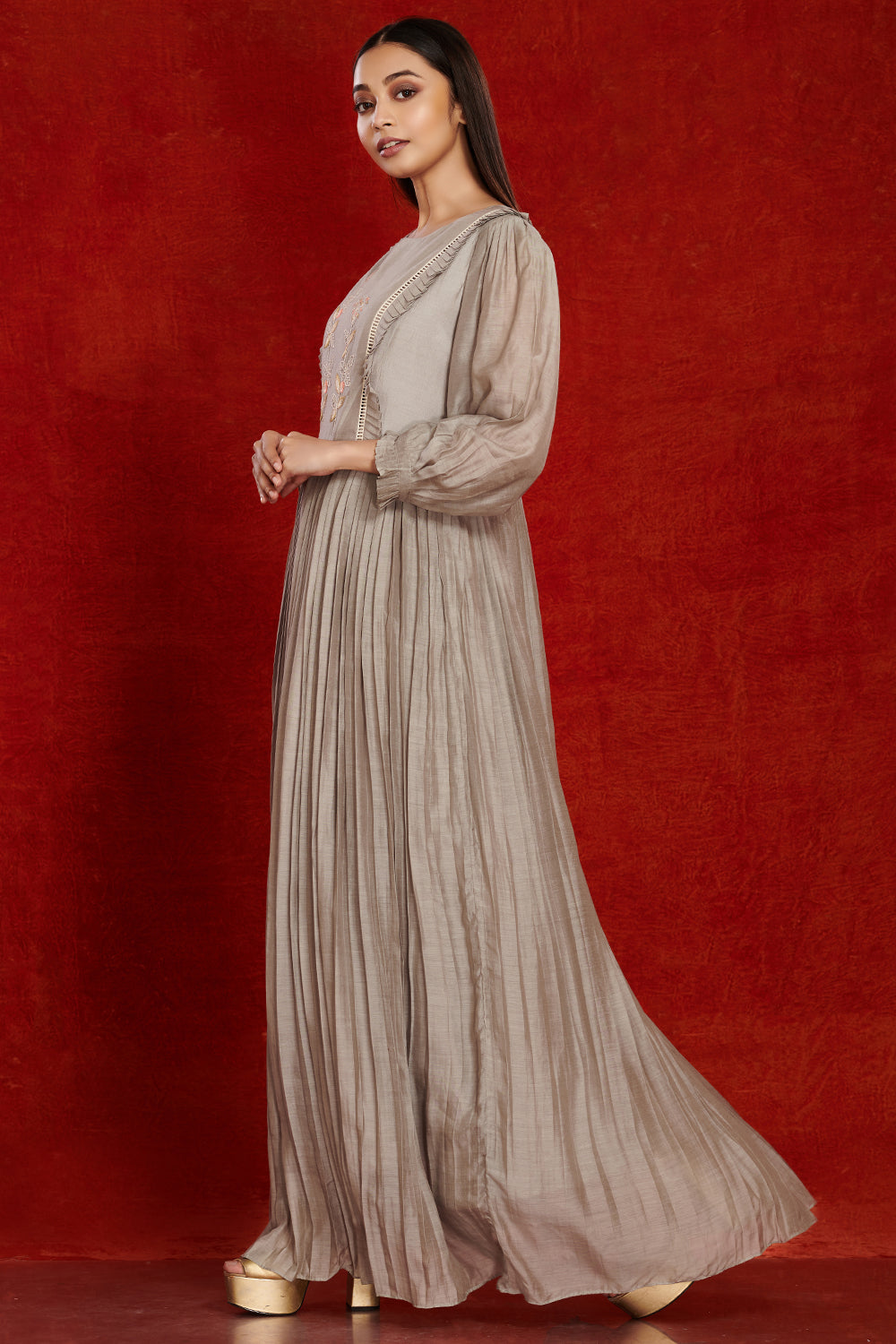 Buy stunning grey balloon sleeves muslin gown online in USA with pastel embroidery. Make a fashion statement on festive occasions and weddings with palazzo suits, sharara suits, partywear dresses, salwar suits from Pure Elegance Indian fashion store in USA.-full view