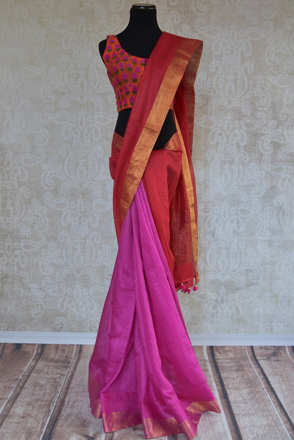 90C275 Red and pink saree online at Pure Elegance with a soft gold border. The plain tussar saree is a versatile Indian ethnic outfit, great for festive occasions and pujas.