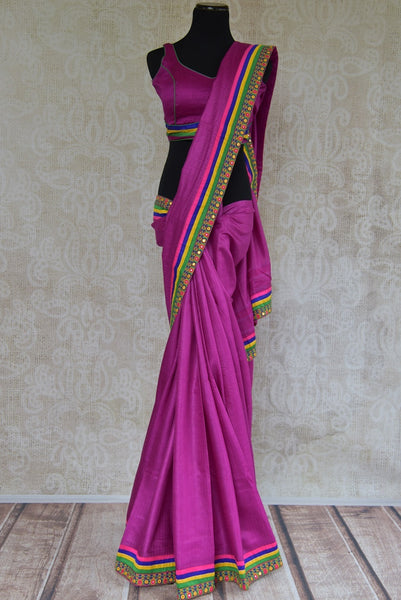 90B026 Purple plain saree with a multi-colored mirror border. The tussar saree, available at our Indian ethnic wear store makes a great Indian wedding reception outfit, as well as a wonderful party wear saree.