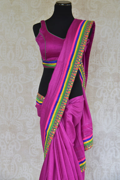 90B026 Purple plain saree with a multi-colored mirror border. The tussar saree, available at our Indian ethnic wear store makes for a great Indian wedding reception outfit, as well as a wonderful party wear saree. Buy it online at Pure Elegance in USA.